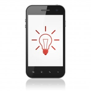 Business concept: Light Bulb on smartphone