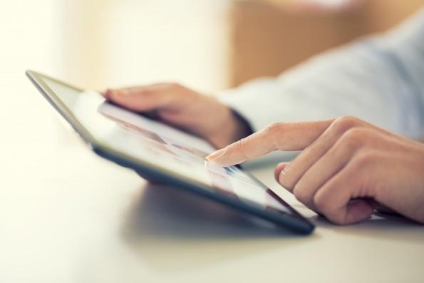 Woman using digital tablet indoor